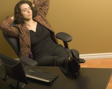 Woman Resting At Her Desk