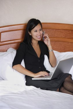 Woman Working On Computer And On Phone