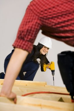 Carpenters Working With Power Tools