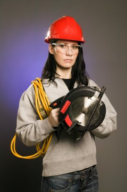 Tradeswoman With Extension Cord And Electric Saw