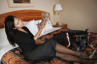 Woman Admiring New Shoes