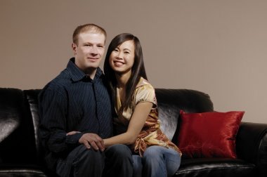 Couple Sitting Close On Couch