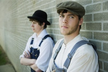 Two Young Men In Old-Fashioned Garments