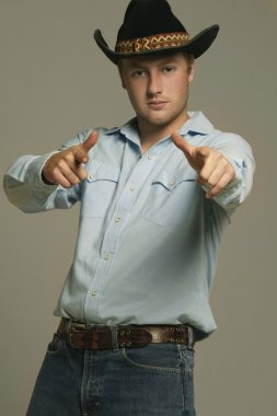 Cowboy Pointing With Two Hands Ahead