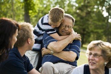 Child Hugs Grandfather