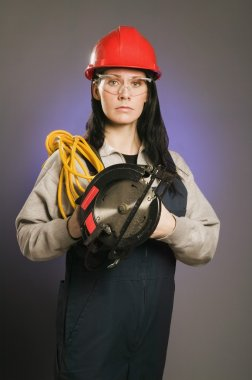 Tradeswoman Holding An Extension Cord And A Power Saw
