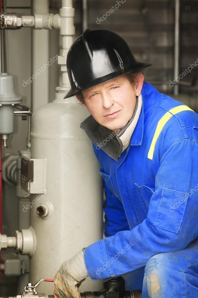 Industrial Worker Adjusting Equipment
