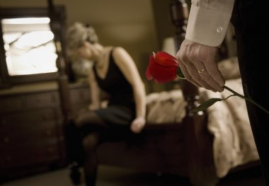 Man's Hand Holding Rose For Woman