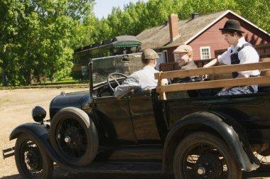 Men In A Vintage Car