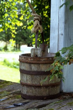 Old Water Bucket On Top Of Well