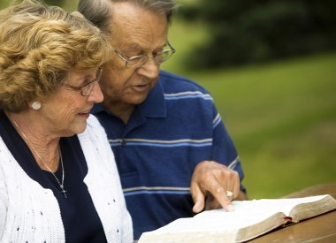 Senior Couple Reading The Bible