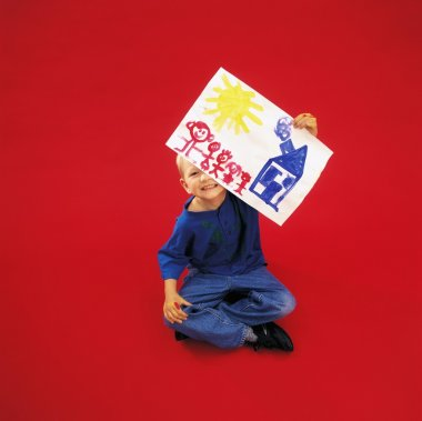 A Boy Holding Painting