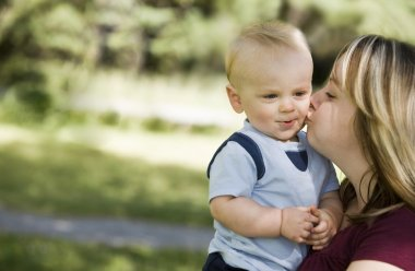 A Mother Kissing A Boy