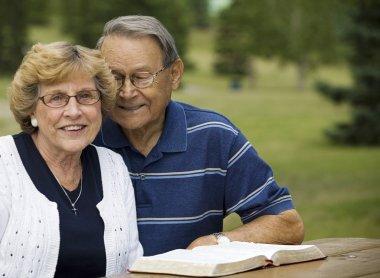 Senior Couple With Their Bible stock vector