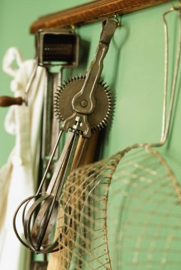 Vintage Kitchen Gadgets Hanging On A Wall