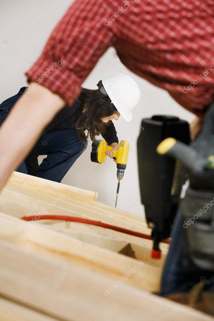 Carpenters Working With Electric Tools