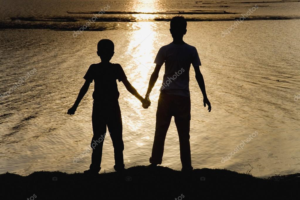 Two Boys At The Water's Edge