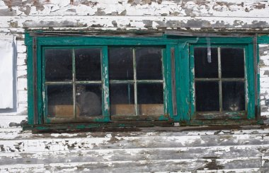 Cat Looking Out The Window Of A Weather Beaten Country House