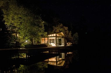 Cottage Lit Up At Night, Lake Of The Woods, Ontario, Canada