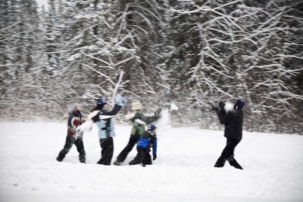A Group Of Children Having A Snowball Fight