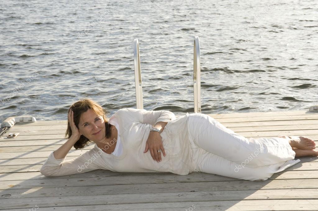 Woman relaxing on dock