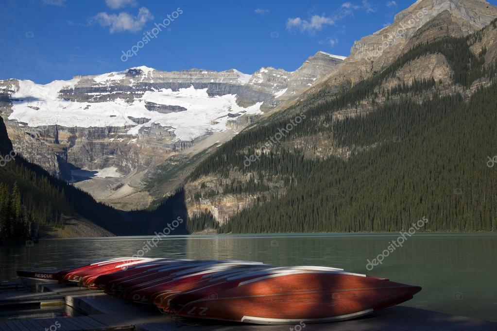 Canoes On Dock At Lake Louise In Banff National Park, Alberta, Canada