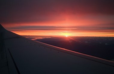 The Wing Of A Plane Against A Sunset