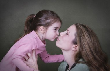 Mother And Daughter Kissing