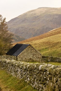 Stone House With Stone Fence