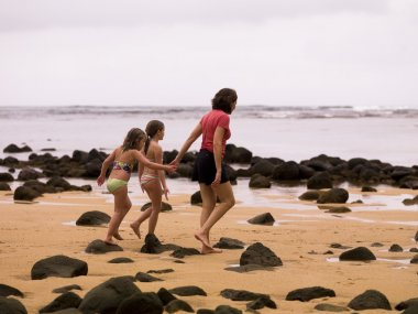 Walking Along A Beach In Kauai, Hawaii, Usa