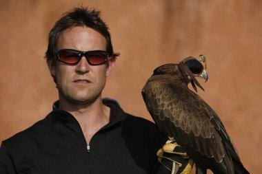 A Black Kite Bird (Milvus Migrans) And A Falconer