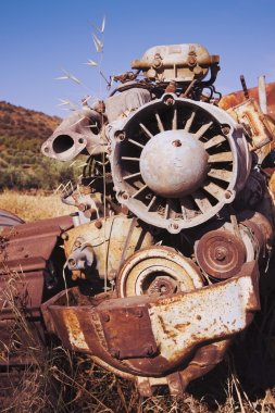 Rusting farm machine abandoned in field