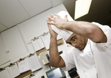 Chef Putting Hat On