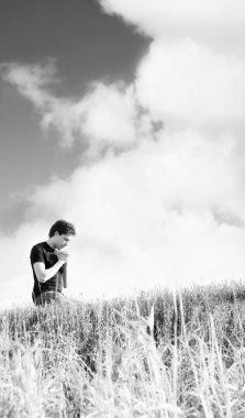 Man Praying Outdoors