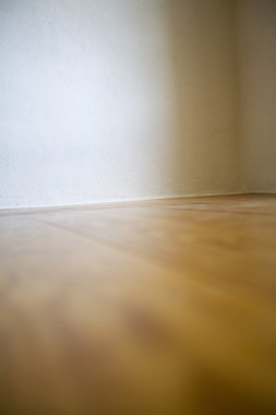 Empty Room With Wooden Floors And White Walls