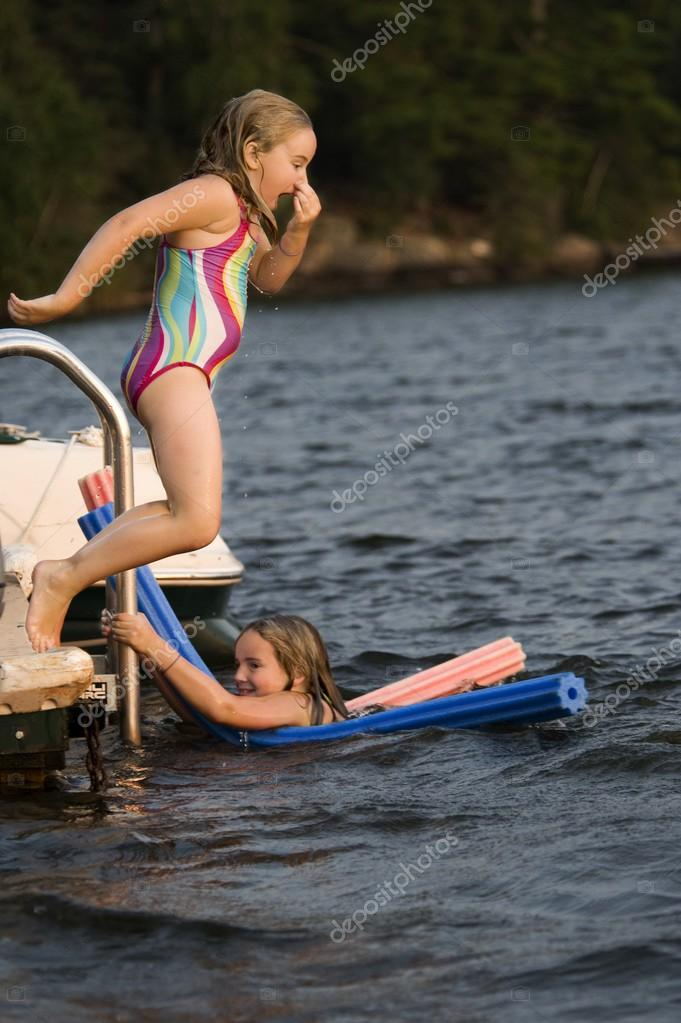 Young girls playing in lake