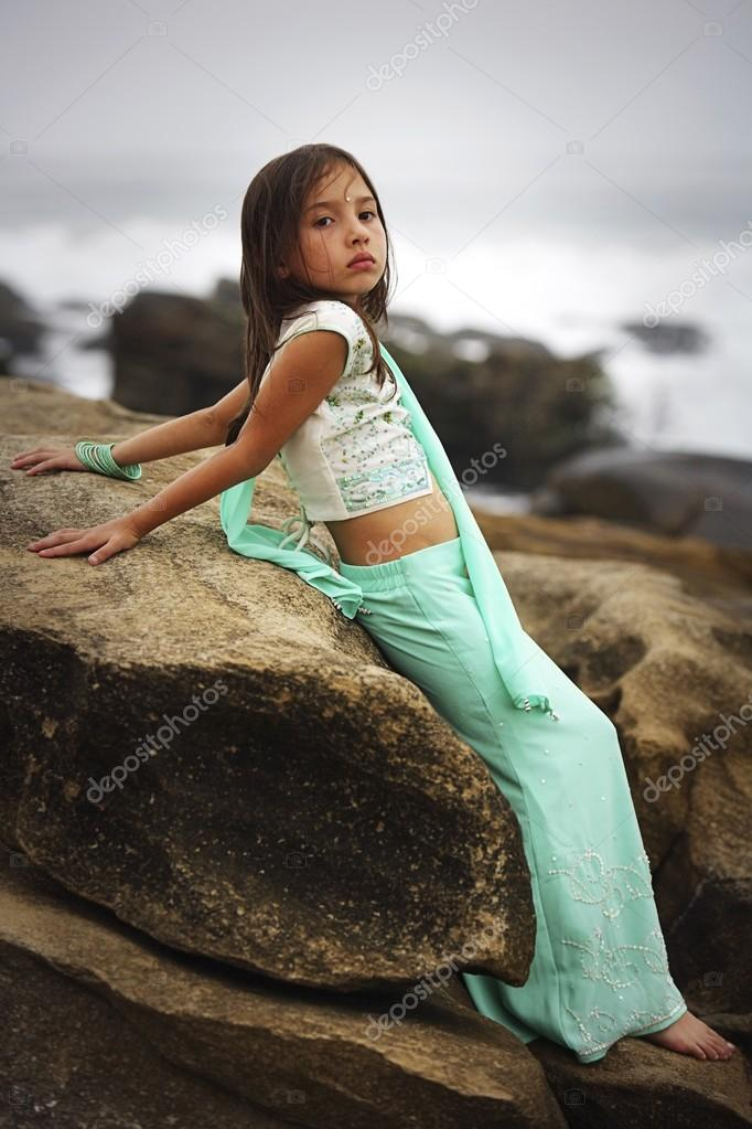 Girl Leaning On A Large Rock