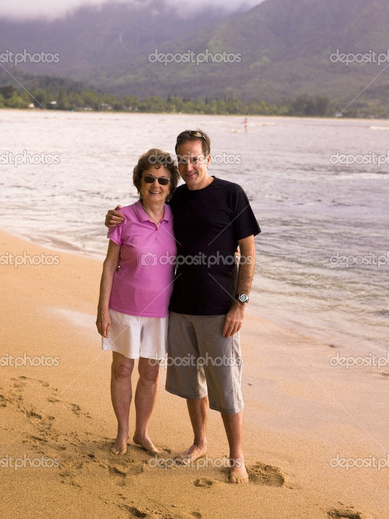Couple On Beach In Kauai, Hawaii, Usa