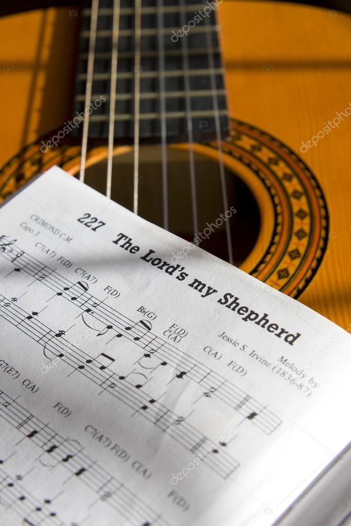 Guitar And Book Of Music