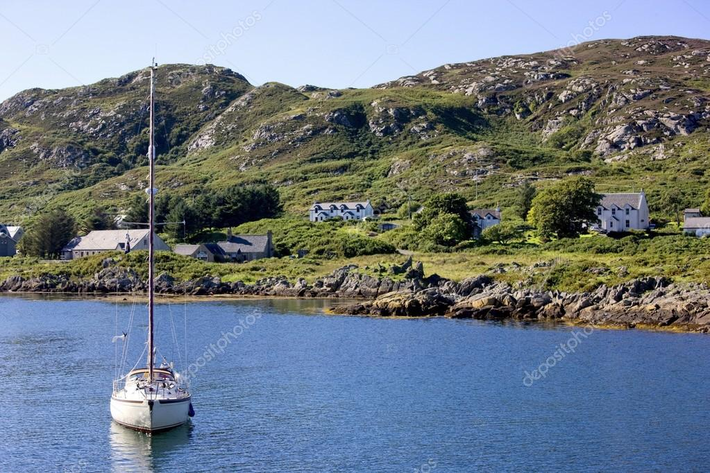 Colonsay, Scotland. View Of Boat Anchored Near Village