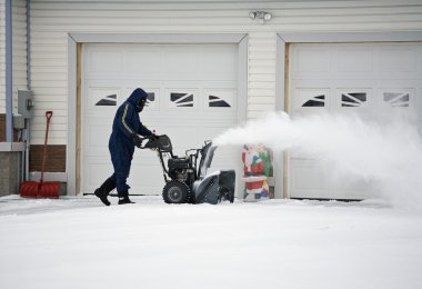 Man Operating A Snow Blower