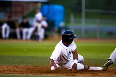 Baseball Player Sliding Onto A Base