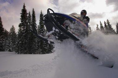 Man Jumping A Snowmobile