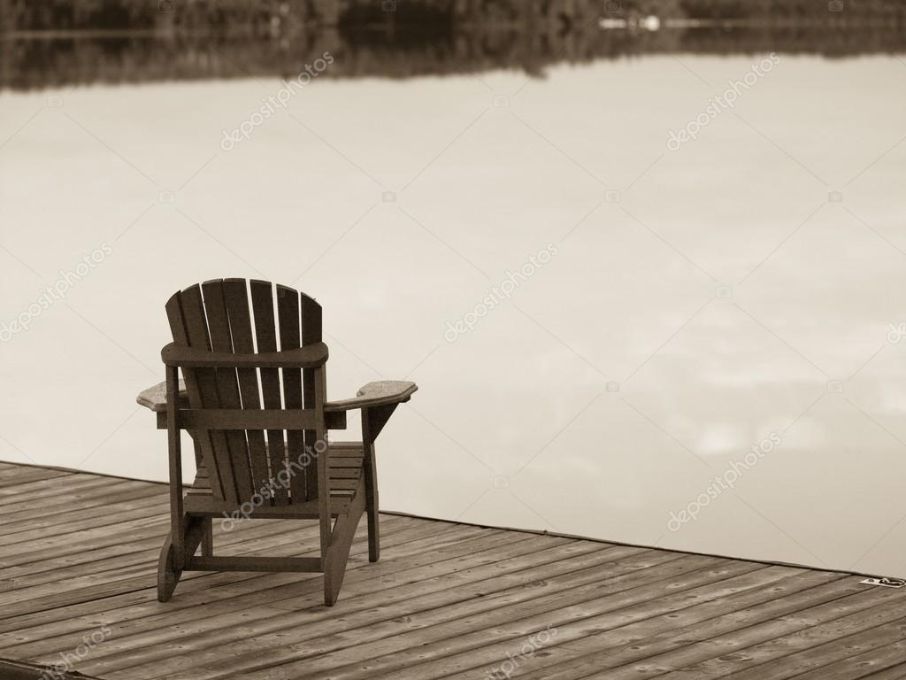 Lake Of The Woods, Ontario, Canada. Empty Deck Chair On A