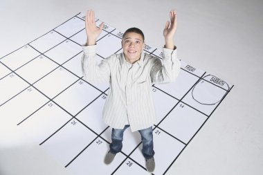 Teenage Boy Standing On A Calendar