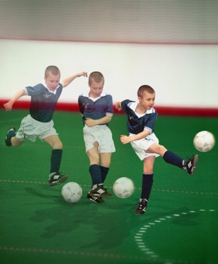 Multiple Exposure Of Boy Plays Soccer