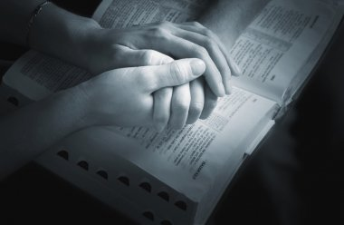 Holding Hands Over The Bible