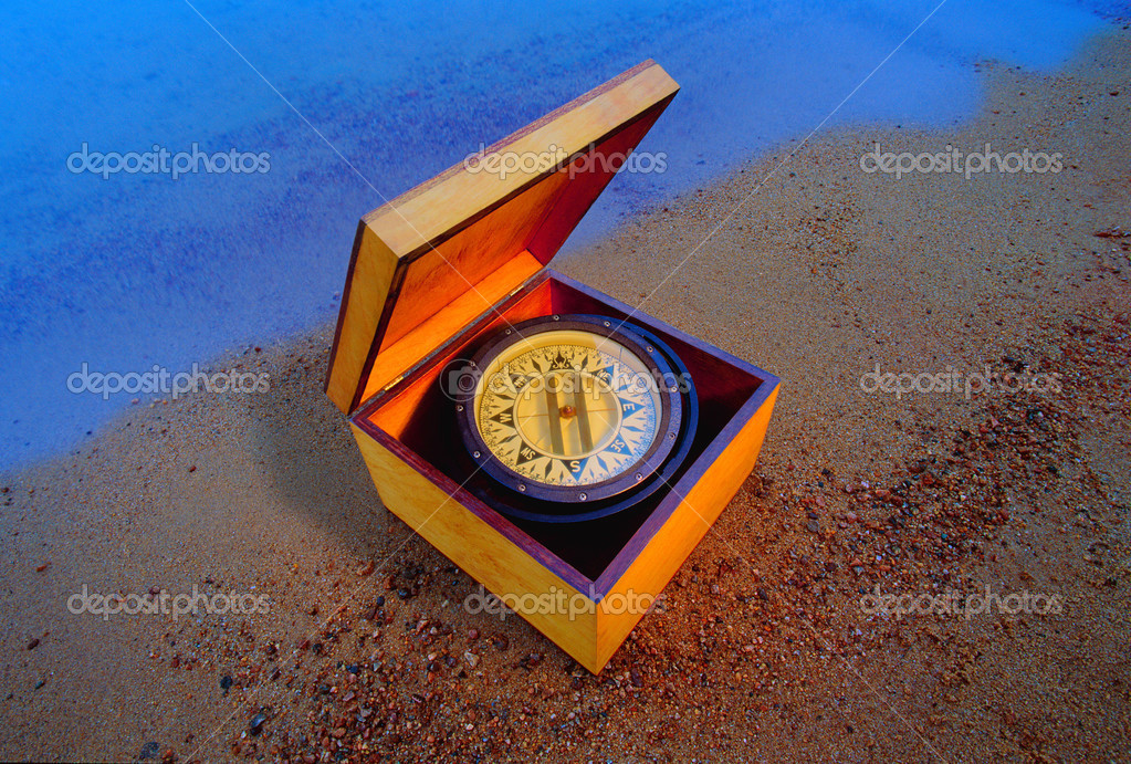 Compass In A Box On The Beach