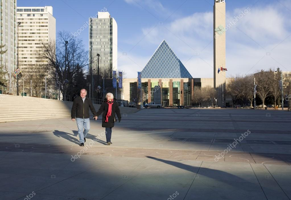 Senior Couple Walking Through Churchill Square, Edmonton, Alberta, Canada