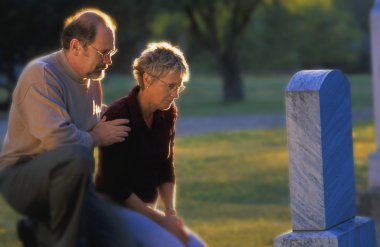 Couple Visiting Grave
